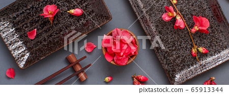 Chopsticks, rectangular plates and pink flowers on 65913344