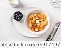 Homemade tiny cereal pancakes with blueberries 65917497