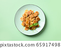 Homemade tiny cereal pancakes with honey in green 65917498