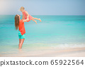 Beautiful mother and daughter on the beach enjoying summer vacation 65922564