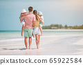 Happy family on the beach during summer vacation 65922584