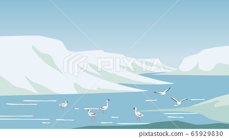 Flamingo hunting and relaxing in the lake located between mountains 65929830
