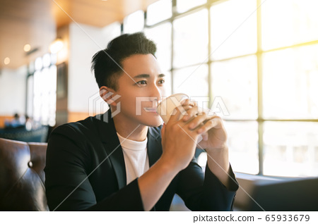 young Business man  Working On Laptop and drinking 65933679