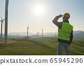 Technician Engineer in Wind Turbine Power Generator Station 65945296