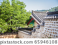 The beauty of hanok with a tree and fence 65946108