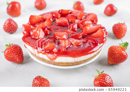 cheesecake with strawberry and fresh berries on gray table 65949221