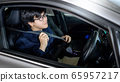 Driving safety. Asian businessman fasten seat belt 65957217