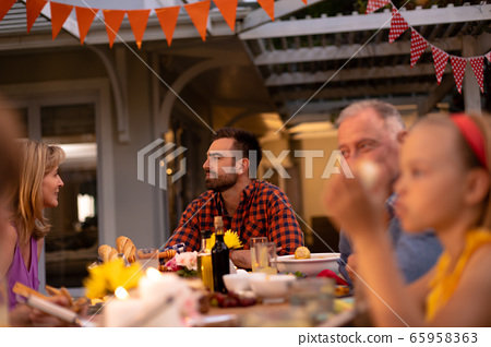 Happy Caucasian family eating together at table 65958363