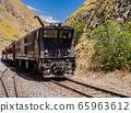 Impressive view of Devil's Nose train running on beautiful andean landscape, Alausi, Ecuador 65963612