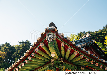 Korean traditional wooden roof eaves at Seoknamsa temple in Anseong, Korea 65970300