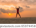 Adorable happy little girl on white beach at 65974458
