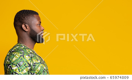 Profile picture of young african man over yellow background 65974809