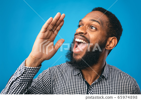 Black guy holding hand near mouth, screaming aside 65974898