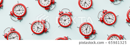 Red Alarm Clocks on Light Blue Background 65981325