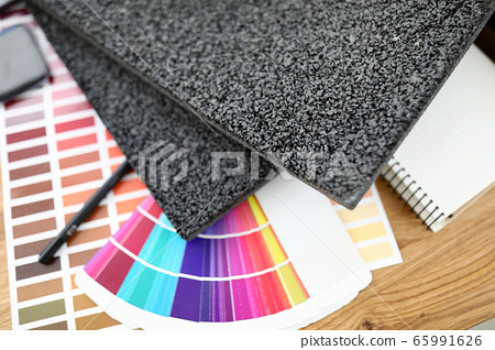 On table are carpet samples bright color palette 65991626