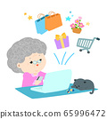 Grandmother shopping online with credit card 65996472
