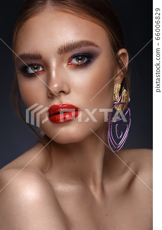 Beautiful girl with bright fashionable make-up and unusual purple accessories. Beauty face. 66006829