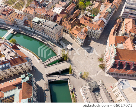 Aerial drone view of Preseren Squere and Triple Bridge over Ljubljanica river,Tromostovje, Ljubljana, Slovenia. Empty streets during corona virus pandemic social distancing measures 66017073