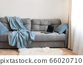 Cozy living room. Laptop on sofa. Home interior. 66020710