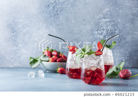 Red cocktail with ice and fresh strawberry 66021215
