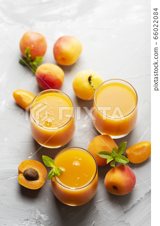 Fresh apricot juice on the marble table 66022084