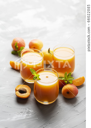 Fresh apricot juice on the marble table 66022085