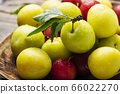 Fresh sweet plums on the wooden table 66022270