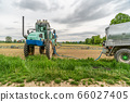 tractor adapted for spraying weeds and pests in field 66027405