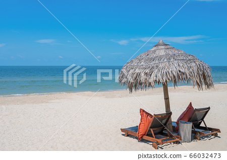 Two Chairs Under Parasol In Tropical Beach 66032473