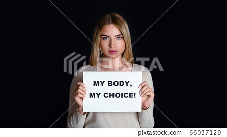 Human rights freedom. Sad girl holds inscription my body my choice 66037129