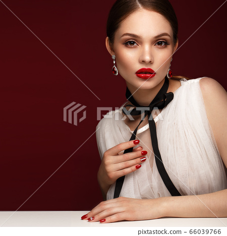Beautiful girl in white dress with classic make-up and red manicure. Beauty face. 66039766