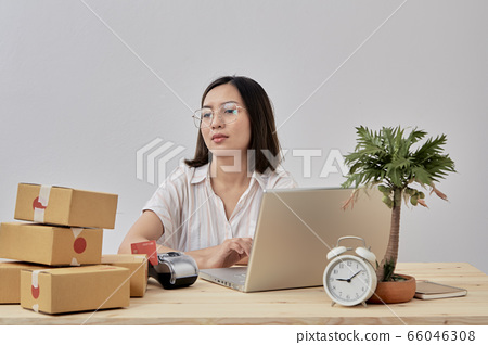 Young woman online seller working from home 66046308