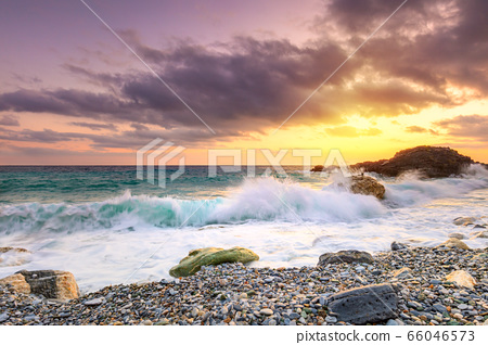 A beautiful scenery of wave splashing at the 66046573