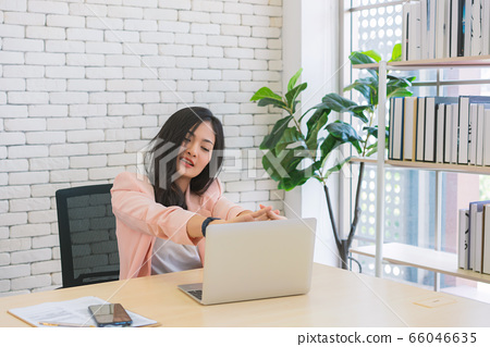business woman work from home and stretching her body because feel tired after working on tablet 66046635