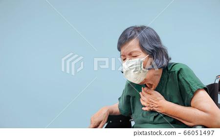 elderly woman cough ,choke on wheelchair 66051497