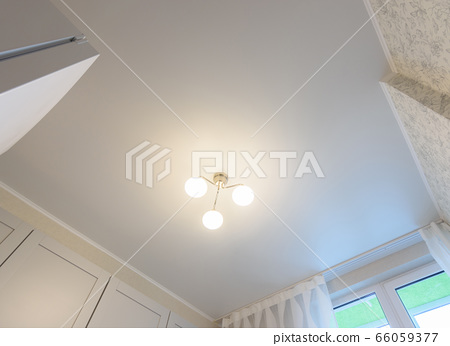 Stretch white matte ceiling in the interior of the 66059377