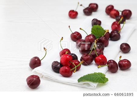 Fresh ripe cherries. 66061895