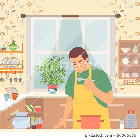Man in Apron Cooking Food in Pan in Kitchen 66066559