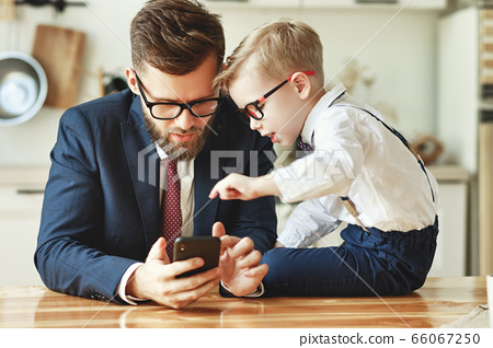 businessman father with a young schoolboy son 66067250