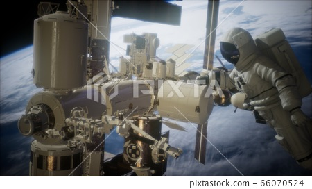 International Space Station and astronaut in outer 66070524