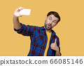 Young pretty man taking selfie on smartphone 66085146