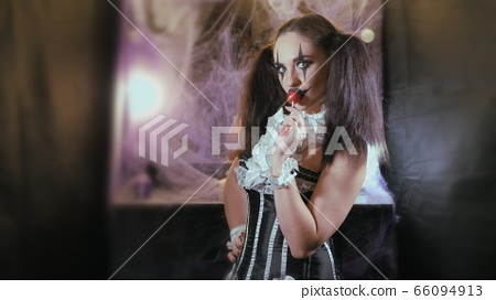 Portrait of a woman. A clown with a smile in 66094913