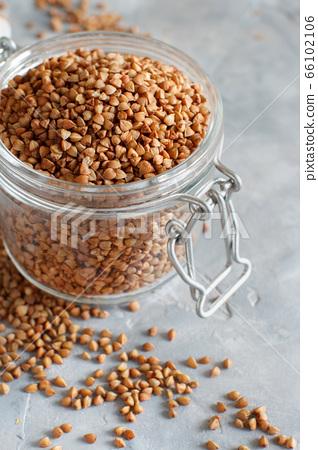 Raw dry buckwheat grain  in a jar 66102106