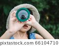Girl with binoculars. 66104710