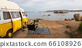 Old colorful retro camper van on camping site at beautiful rocky coastal landscape of Costa Smeralda, north east Sardinia, Italy. Tourism vacation and travel. 66108926