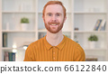 Portrait of Smiling Redhead Man Looking at Camera  66122840