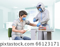 Healthcare workers in face shields and protective clothing pass vaccination of medication to positive patients 66123171