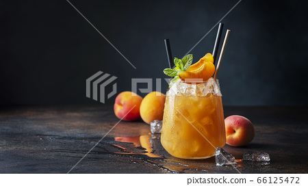 Fresh apricot cocktail with ice and mint 66125472