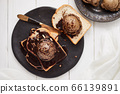 Chocolate ice cream on toast. 66139891