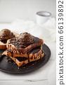 Chocolate ice cream on toast. 66139892